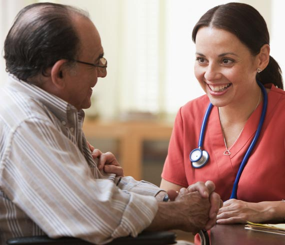 Image of nurse caring for adult client.